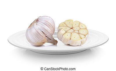 Garlic in a plate on white background