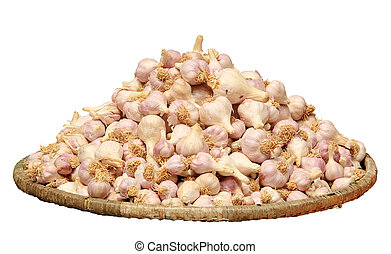 Garlic in a wicker basket on tne white background