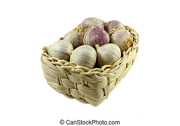 garlic in basket on white background