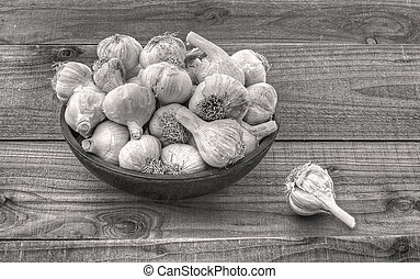 garlic in bowl on wooden table