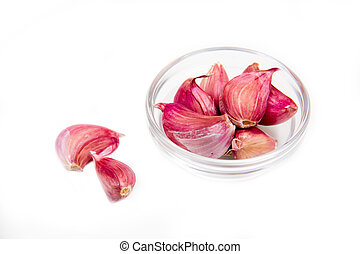 Garlic in glass bowl on white background