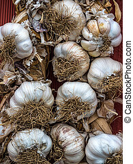 garlic is for sale on a vegetable market