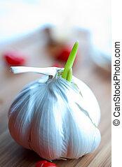 Garlic on a cutting wooden board