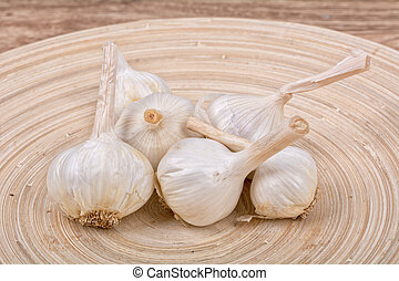 Garlic on a wooden bowl