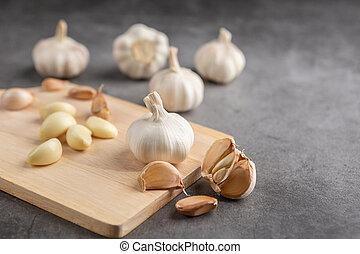 Garlic on the black cement floor.