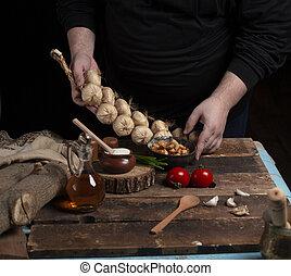 garlic on the hand with dark background