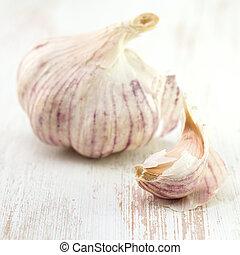 garlic on white wooden background