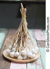 garlic on wooden background