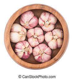 Garlic on wooden bowl top view of white background