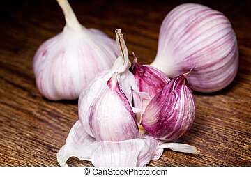 Garlic on wooden brown background