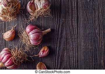 Garlic on wooden vintage background.
