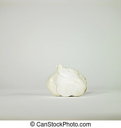 Garlic - White garlic head on a table