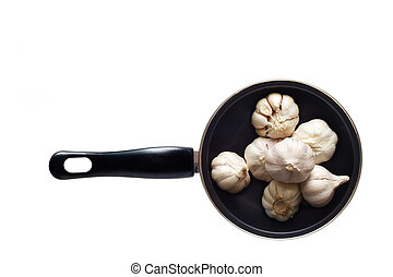 garlics in the pan on isolated white background, blank text