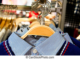 garment hanging on hangers in a store