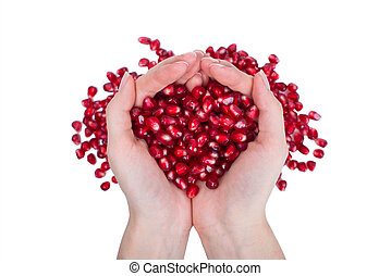 garnet, grains, pomegranate seeds in female hands.