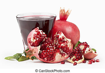 Garnet juice in a glass and pomegranate on the white
