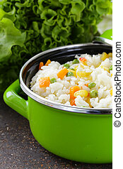garnish rice with various vegetables (carrots, corn and ...