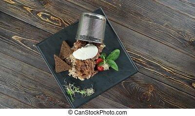 Garnished barley porridge. Healthy food on wooden...