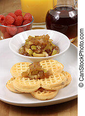 Exquisite belgian waffle garnished with organic apple sauce