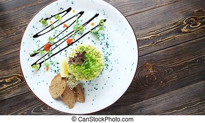 Garnished food top view. Herring tartare, toasts and caviar.