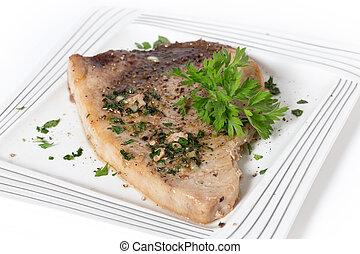 Garnished swordfish steak - Swordfish steak cooked on a...