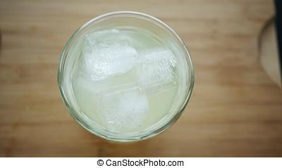 Garnishing Lemonade - Garnishing lemonade cocktail with...