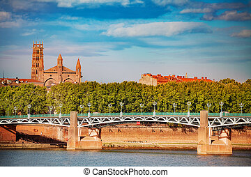 Beautiful view of Garonne river embankment with Pont Saint Pierre and Couvent des Jacobins in Toulouse, France