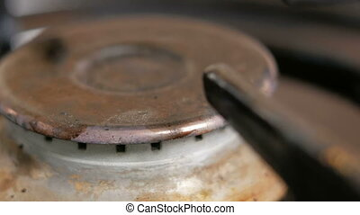 Gas burner cooker ignited. Very close up