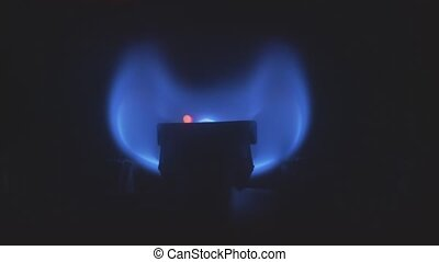 Gas burner flame inside household heat system closeup