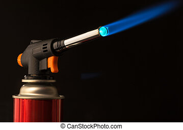 gas burner - the tool is lit a blue flame