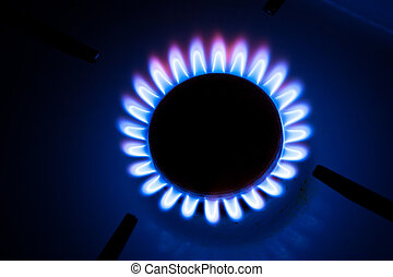 Gas burning by a dark blue flame on  kitchen