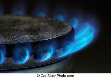 Gas burning by a dark blue flame on modern kitchen