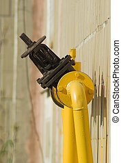 Gas check valve - The gas gate, valve and yellow pipes.