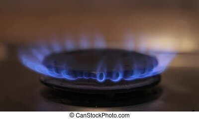 Gas cooker turning on - Turning on gas stove closeup shot,...