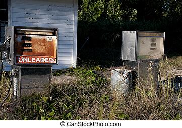 Gas Crisis - Run down gas pumps at an abandoned petrol...