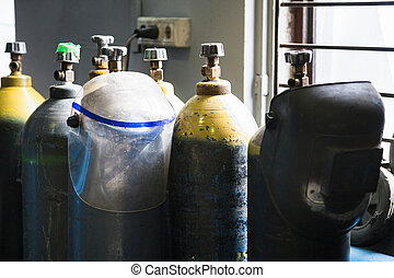 gas cylinders and protection mask in workshop