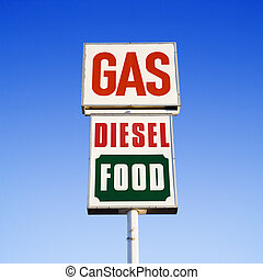 Gas diesel food sign. - Sign against blue sky that reads gas...