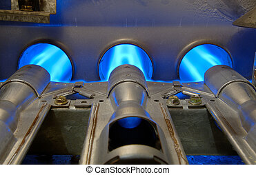 Gas Energy Flames - Inside a gas furnace. Focus = the top of...