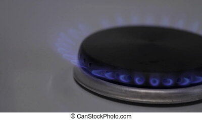 Gas fire burns gas stove in the kitchen