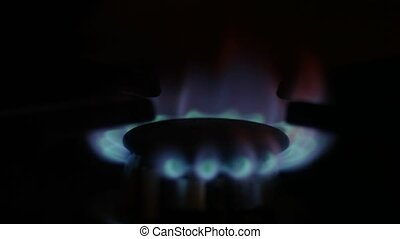 Gas fire in the dark, turning on then off stove gas burner