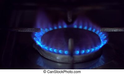 gas fire on the stove - flash of gas on the stove and then a...