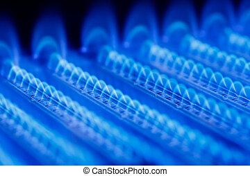 Gas flame - Blue flames of a gas burner inside of a boiler