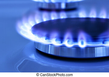 Gas flame - Blue gas flame on the hob close up