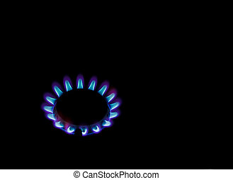 Gas flames - Burning ring flames of gas stove on black...