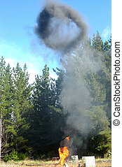 gas flare - Smoke ring from flare burning off gas and oil at...