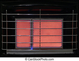 Gas Heater - A close up of the heating ceramic of a switched...