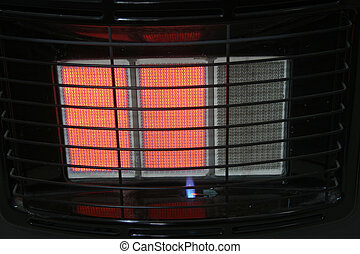 gas heater - a gas heater switched on for the winter cold