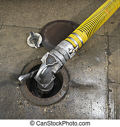Gas hose. - Hose carrying fuel to storage.