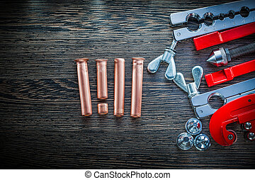 Gas line flaring tools on wooden board