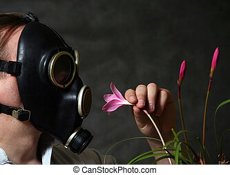 Gas mask  - The man in a gas mask with flowers